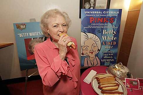 Betty White with her Signature Pink's Hot Dog